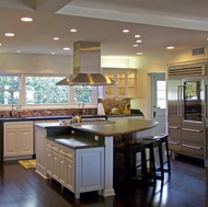 Luxury White Kitchen with a Large Island and Pearlescent Backsplash - Designer Kitchens LA