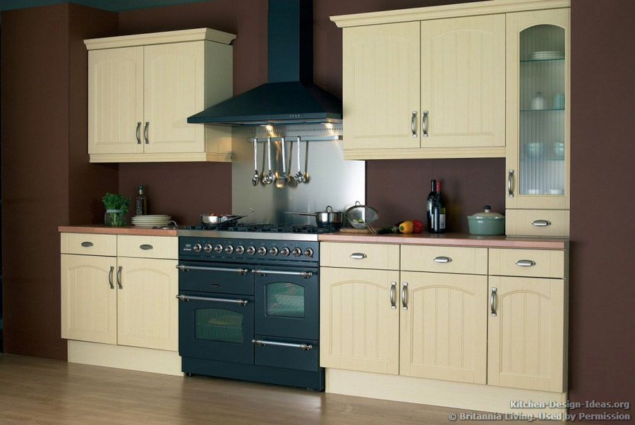 A Butter Yellow Kitchen With A Graphite Black Double Oven Range. Cooking ...