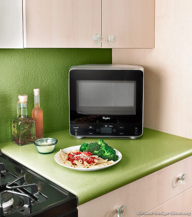 This Mini Whirlpool Microwave (WMC20005YD) Has An Oval Shaped Back For  Fitting Into