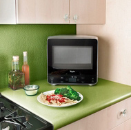 This mini Whirlpool microwave (WMC20005YD) has an oval-shaped back for fitting into a corner.